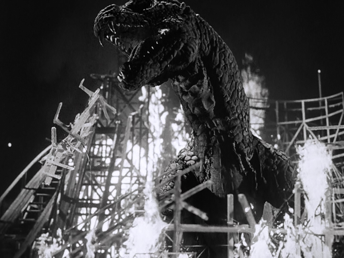 A burning roller-coaster and a dinosaur.  How cool is that?
