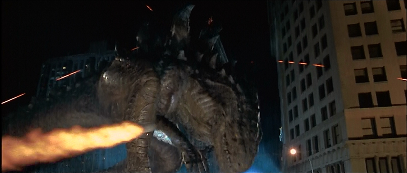 Godzilla ducks a missile.