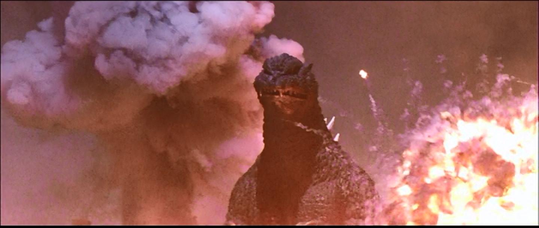 Godzilla, walking through explosions