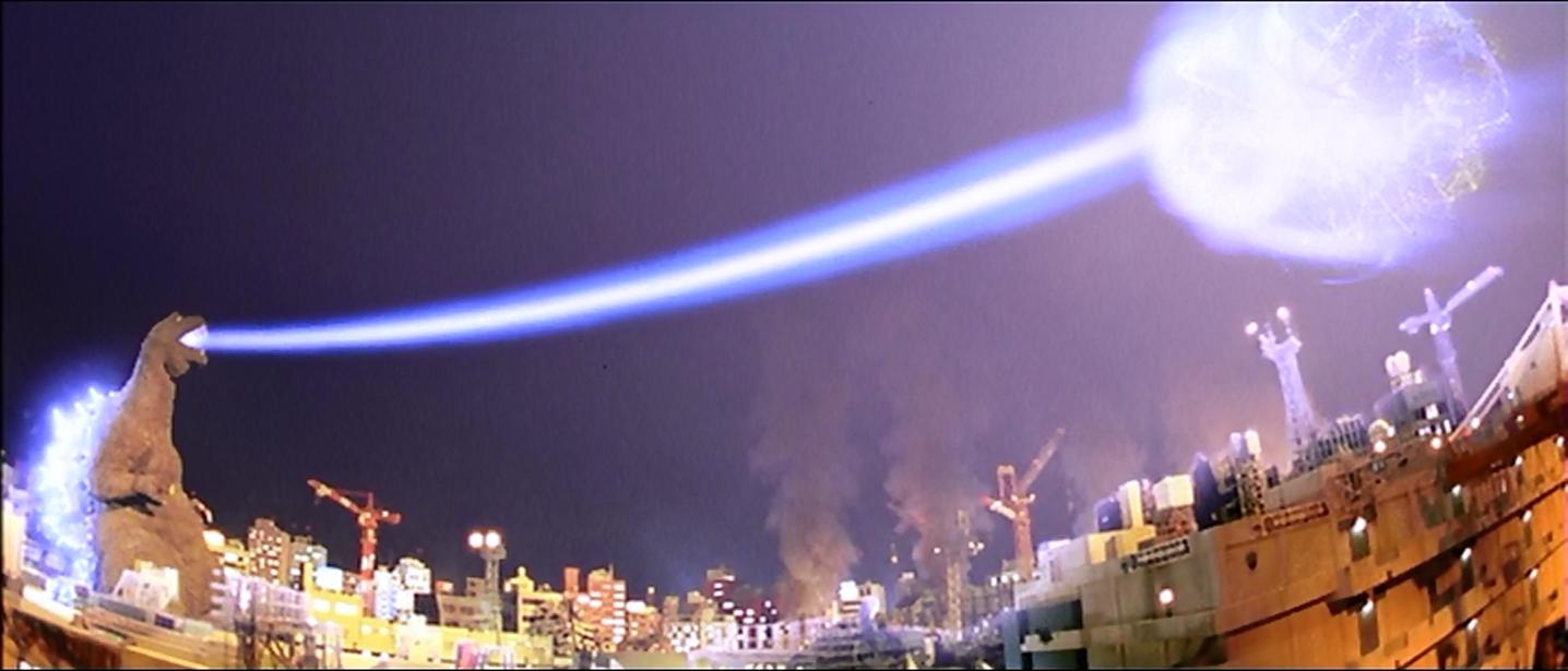 Godzilla blasts Ghidorah.