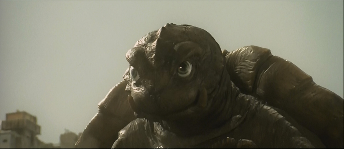 Gamera, following in Gorgo's tiretracks