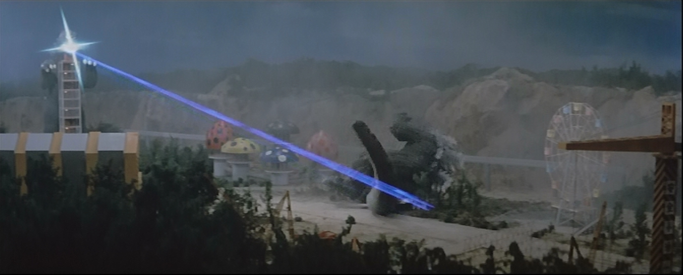 Godzilla having his ass kicked by a building. Ironic as all hell.