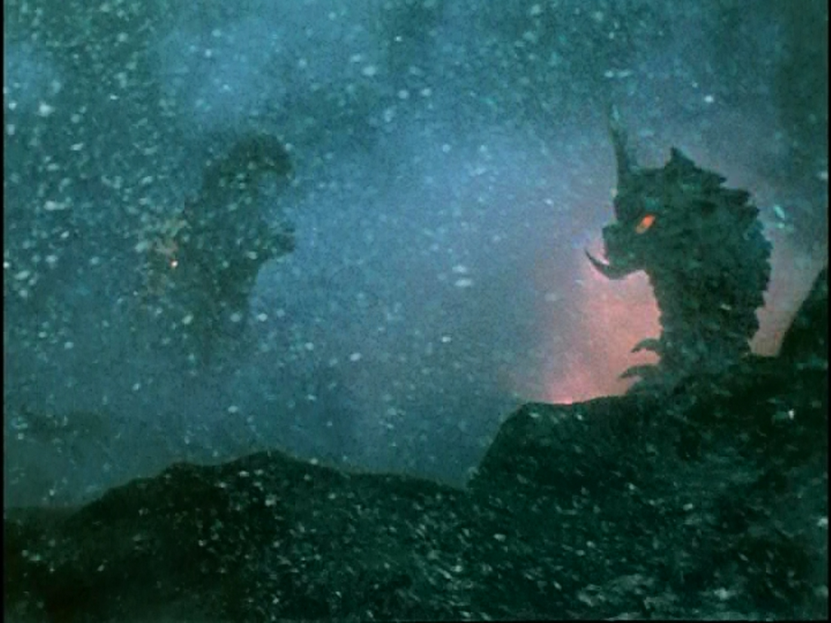 Battra and Godzilla fight so hard they open a magma fissure
