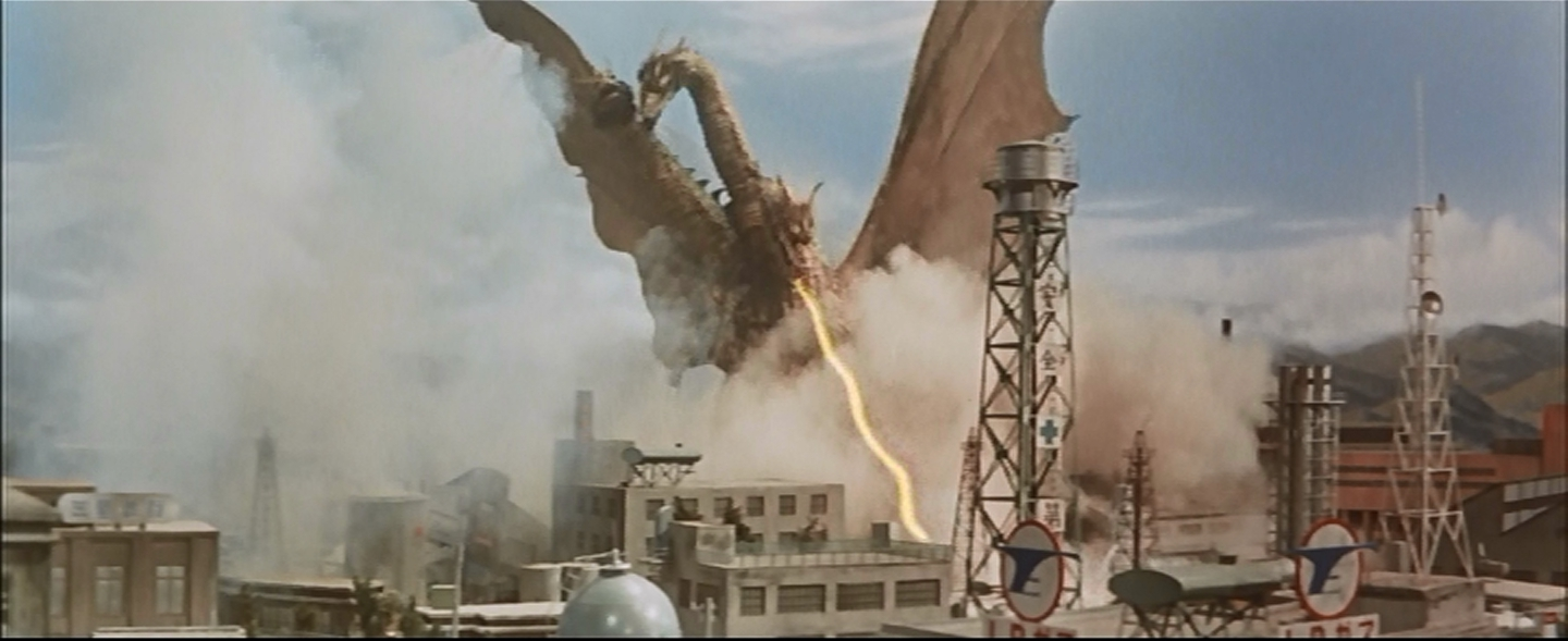 Ghidorah stomps a refinery.  With antennas and stuff.