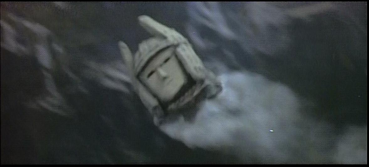 Daimajin's statue head flies through the air.